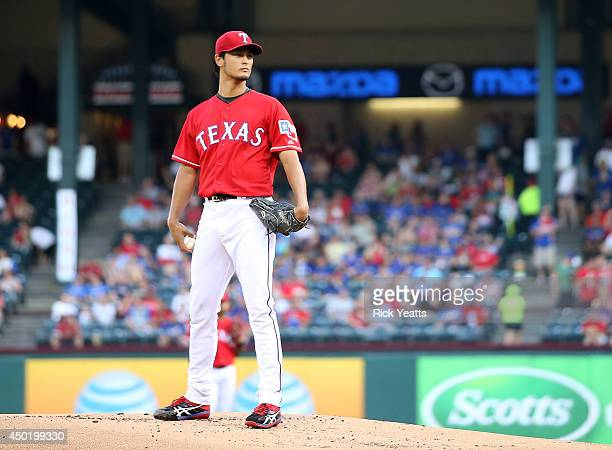 Yu Darvish of the Texas Rangers throws in the first inning against the Cleveland Indians at Globe Life Park in Arlington on June 6 2014 in Arlington...