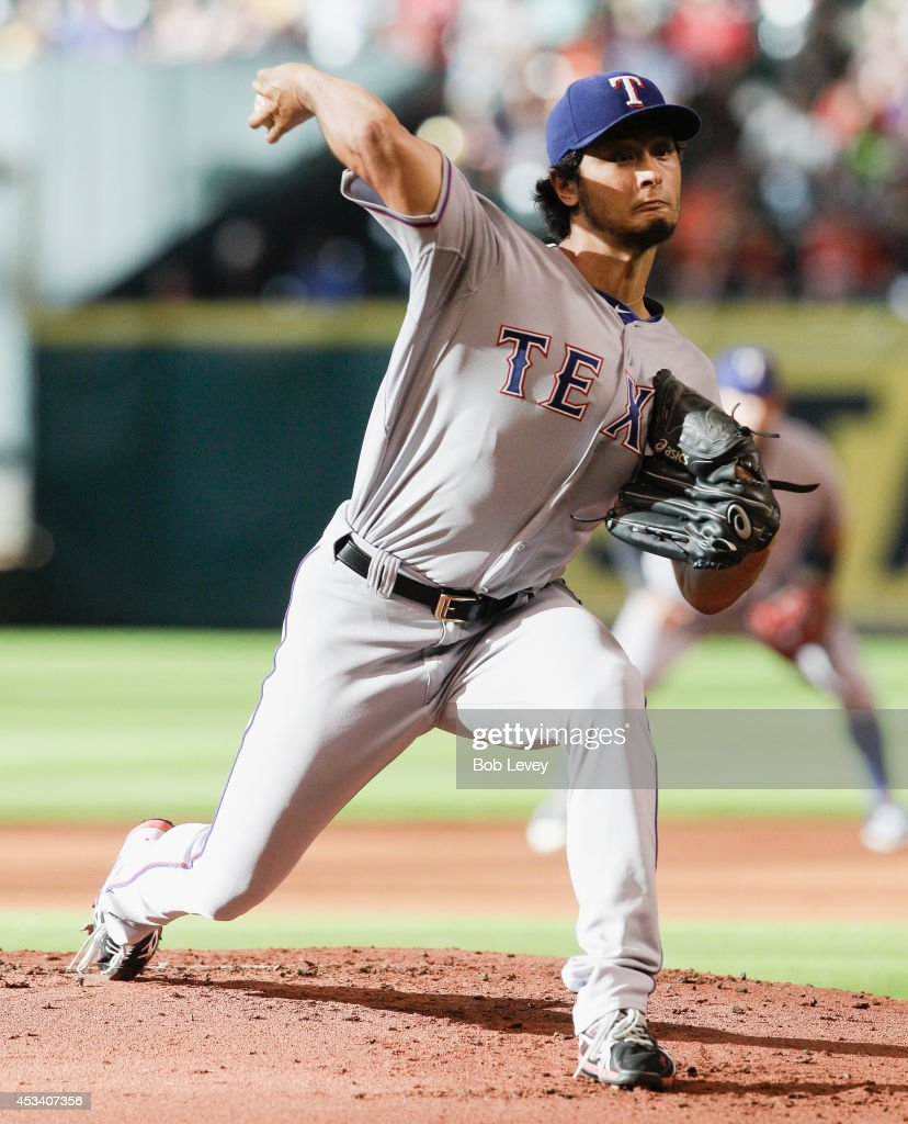 <a gi-track='captionPersonalityLinkClicked' href=/galleries/search?phrase=Yu+Darvish&family=editorial&specificpeople=4018539 ng-click='$event.stopPropagation()'>Yu Darvish</a> #11 of the Texas Rangers throws in the first inning against the Houston Astros at Minute Maid Park on August 9, 2014 in Houston, Texas.