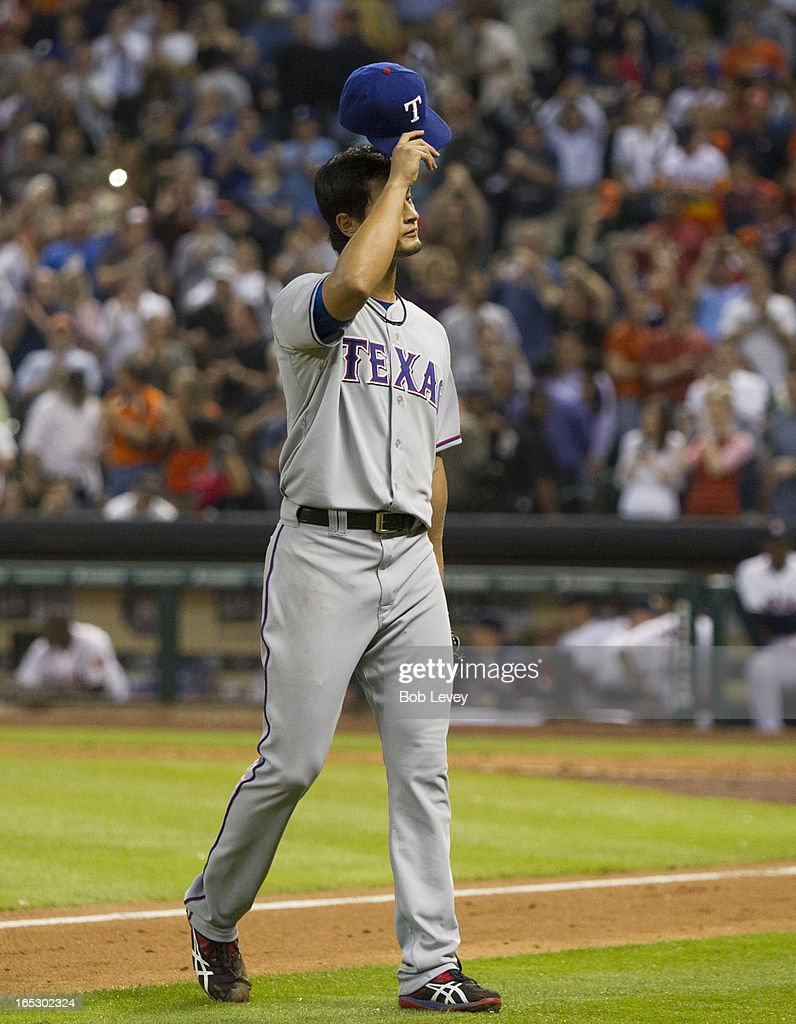 <a gi-track='captionPersonalityLinkClicked' href=/galleries/search?phrase=Yu+Darvish&family=editorial&specificpeople=4018539 ng-click='$event.stopPropagation()'>Yu Darvish</a> #11 of the Texas Rangers tips his hat as he leaves the game in the ninth inning after throwing a near perfect game against the Houston Astros at Minute Maid Park on April 2, 2013 in Houston, Texas. Marwin Gonzalez #9 of the Houston Astros hit a single back up the middle to break up the no hitter.