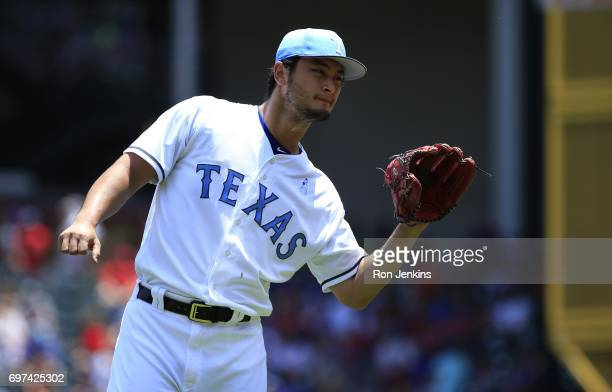 Yu Darvish of the Texas Rangers waits for the ball against the Seattle Mariners during the first inning at Globe Life Park in Arlington on June 18...
