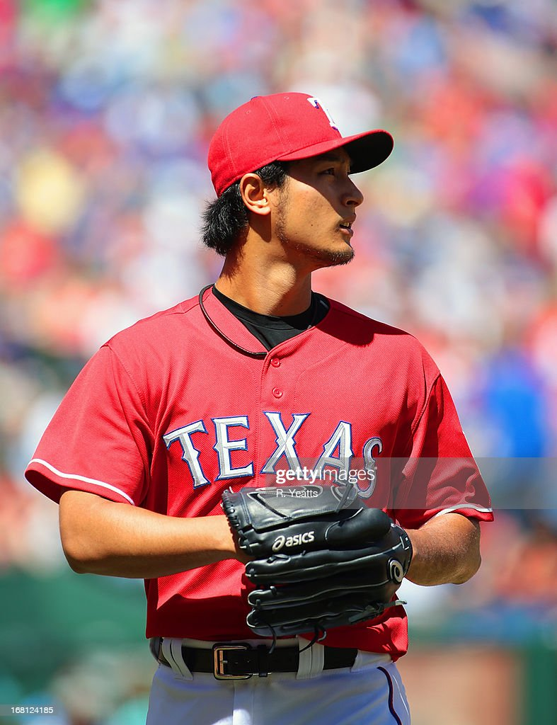 Yu Darvish #11 of the Texas Rangers walk to the dug out after throwing 14 strike out for the game against the Boston Red Sox at Rangers Ballpark in Arlington on May 5, 2013 in Arlington, Texas.