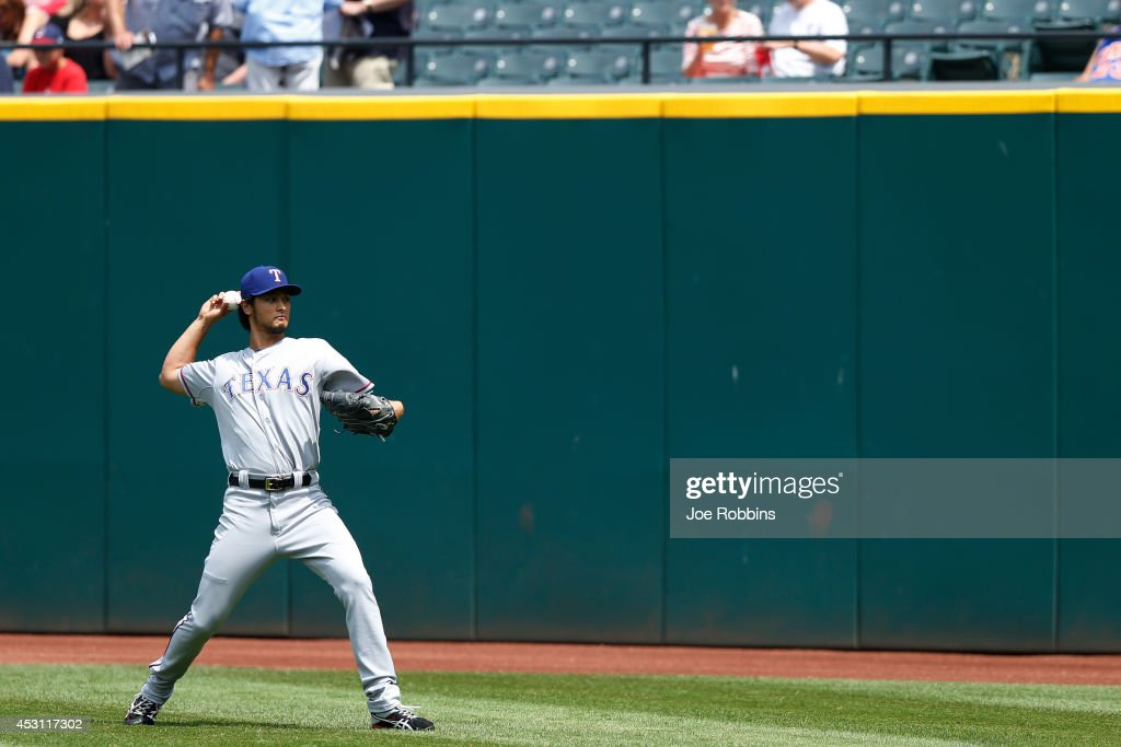 <a gi-track='captionPersonalityLinkClicked' href=/galleries/search?phrase=Yu+Darvish&family=editorial&specificpeople=4018539 ng-click='$event.stopPropagation()'>Yu Darvish</a> #11 of the Texas Rangers warms up before the game against the Cleveland Indians at Progressive Field on August 3, 2014 in Cleveland, Ohio.