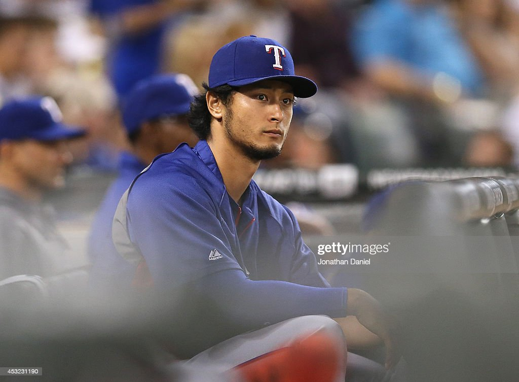 <a gi-track='captionPersonalityLinkClicked' href=/galleries/search?phrase=Yu+Darvish&family=editorial&specificpeople=4018539 ng-click='$event.stopPropagation()'>Yu Darvish</a> #11 of the Texas Rangers watches a game against the Chicago White Sox from the dugout at U.S. Cellular Field on August 5, 2014 in Chicago, Illinois.