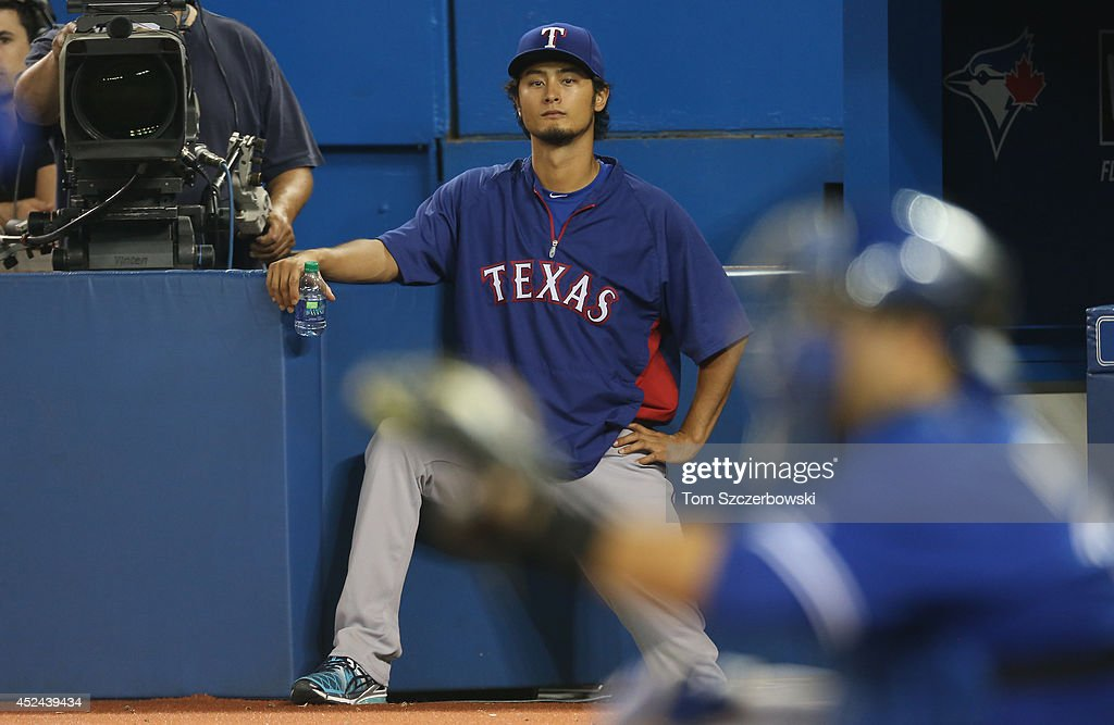 <a gi-track='captionPersonalityLinkClicked' href=/galleries/search?phrase=Yu+Darvish&family=editorial&specificpeople=4018539 ng-click='$event.stopPropagation()'>Yu Darvish</a> #11 of the Texas Rangers watches the action from the end of the dugout during MLB game action against the Toronto Blue Jays on July 20, 2014 at Rogers Centre in Toronto, Ontario, Canada.