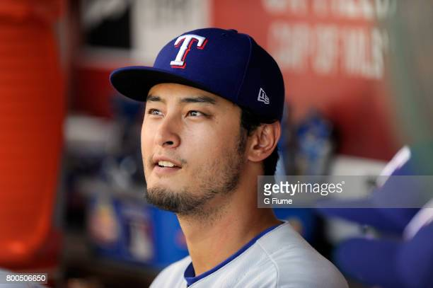 Yu Darvish of the Texas Rangers watches the game during the first inning of the game against the Washington Nationals at Nationals Park on June 11...