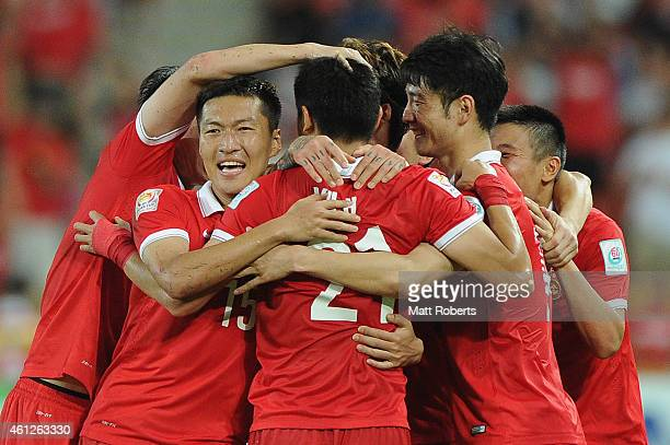 Yu Hai of China PR celebrates scoring a goal ith team mates during the 2015 Asian Cup match between Saudi Arabia and China PR at Suncorp Stadium on...