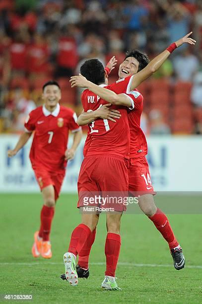 Yu Hai of China PR celebrates scoring a goal with Ji Xiang during the 2015 Asian Cup match between Saudi Arabia and China PR at Suncorp Stadium on...