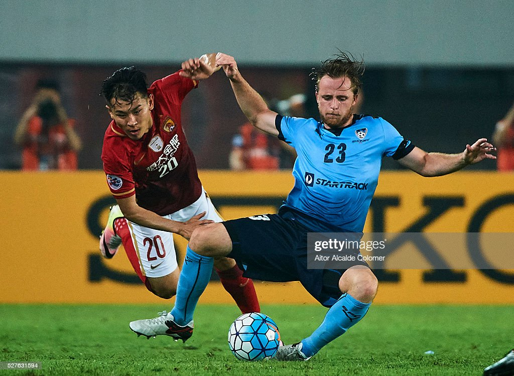 Yu Hancaho of Guangzhou Evergrande (L) competes for the ball with Rhyan Bert Grant of Sydney FC (R) during the AFC Asian Champions League match between Guangzhou Evergrande FC and Sydney FC at Tianhe Stadium on May 3, 2016 in Guangzhou, China.