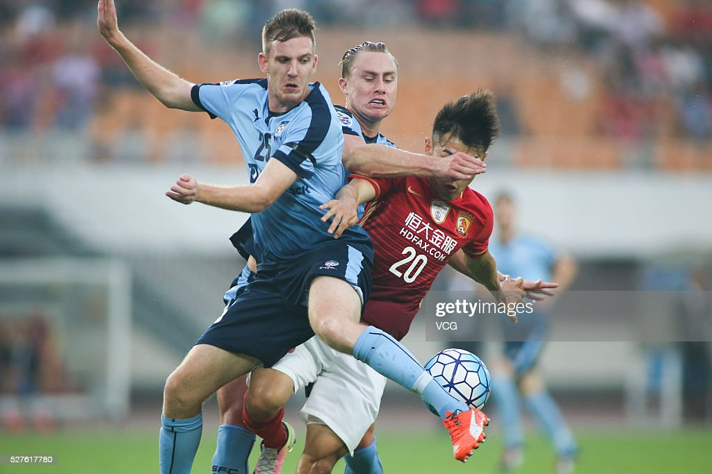 Yu Hanchao #20 of Guangzhou Evergrande and Aaron Calver #25 of Sydney FC compete for the ball during the AFC Asian Champions League match between Guangzhou Evergrande FC and Sydney FC at Tianhe Stadium on May 3, 2016 in Guangzhou, China.