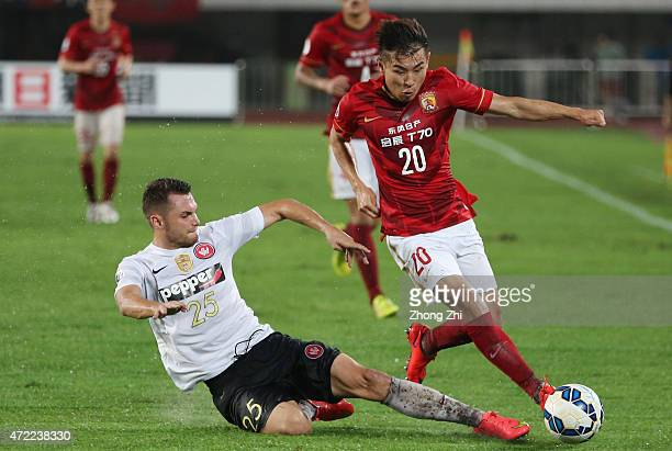 Yu Hanchao of Guangzhou Evergrande competes the ball with Sam Gallaway of Western Sydney Wanderers during the AFC Asian Champions League match...
