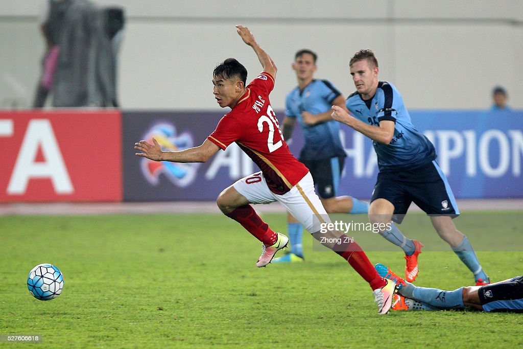 Yu Hanchao of Guangzhou Evergrande in action against AAron Calver of Sydney FC during the AFC Asian Champions League match between Guangzhou Evergrande FC and Sydney FC at Tianhe Stadium on May 3, 2016 in Guangzhou, China.