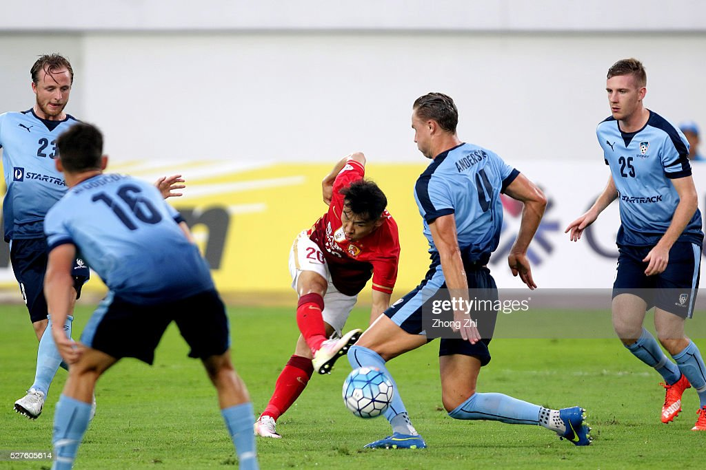 Yu Hanchao of Guangzhou Evergrande in action against Zac Anderson and other players of Sydney FC during the AFC Asian Champions League match between Guangzhou Evergrande FC and Sydney FC at Tianhe Stadium on May 3, 2016 in Guangzhou, China.