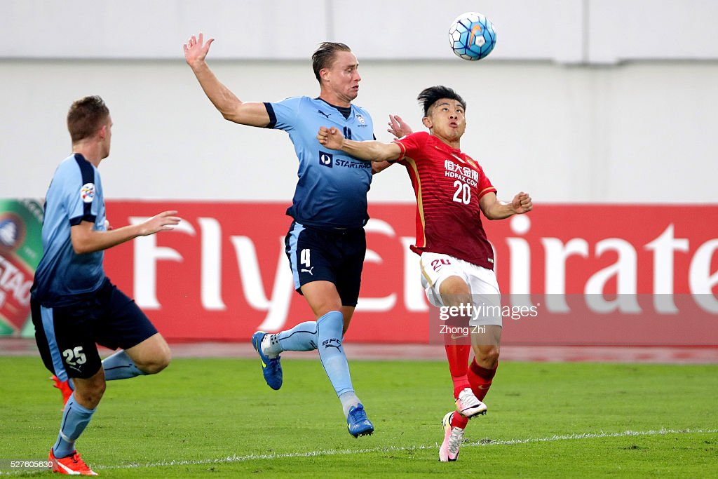 Yu Hanchao of Guangzhou Evergrande in action against Zac Anderson of Sydney FC during the AFC Asian Champions League match between Guangzhou Evergrande FC and Sydney FC at Tianhe Stadium on May 3, 2016 in Guangzhou, China.