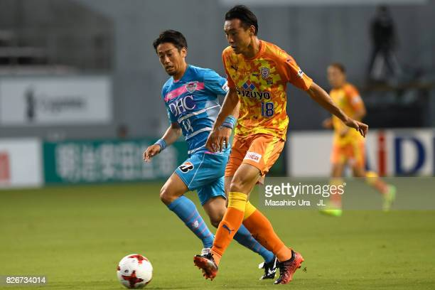 Yu Hasegawa of Shimizu SPulse controls the ball under pressure of Yoshiki Takahashi of Sagan Tosu during the JLeague J1 match between Sagan Tosu and...