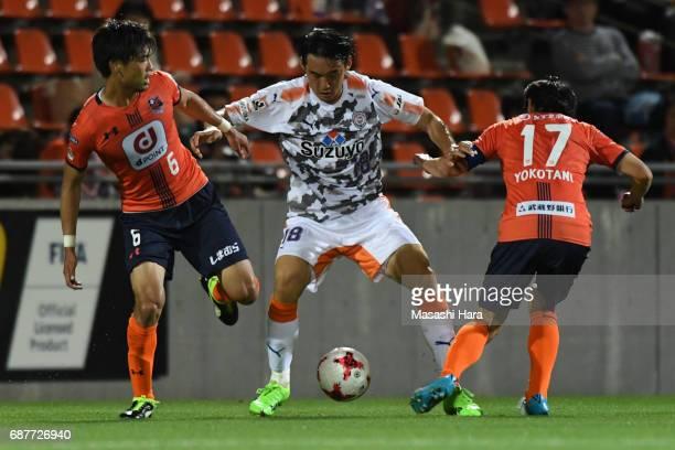 Yu Hasegawa of Shimizu SPulseAkinari Kawazura and Shigeru Yokotani of Omiya Ardija compete for the ball during the JLeague Levain Cup Group A match...