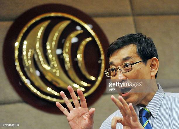 Yu Hsiaocheng vice chairperson of Taiwan's telecom regulator National Communications Commission gestures while unveiling a list of seven local...