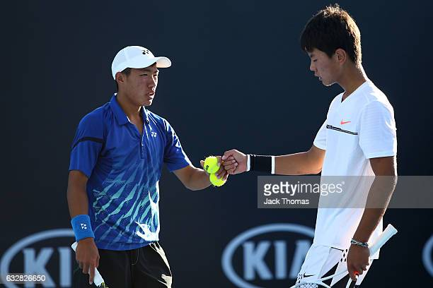Yu Hsiou Hsu of Taipei and Lingxi Zhao of China compete in their Junior Doubles Final match against Finn Reynolds of New Zealand and Duarte Vale of...