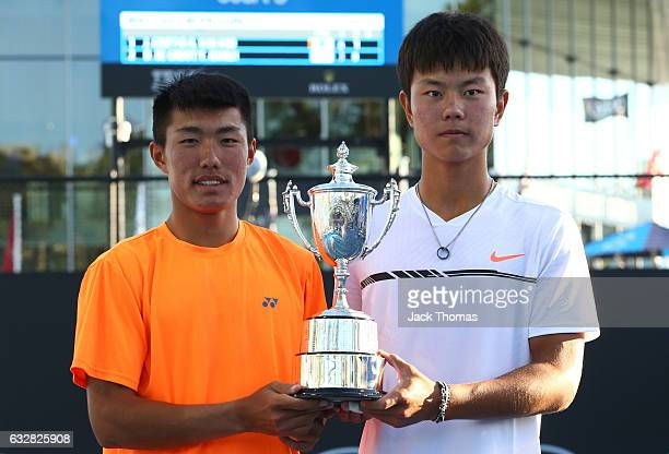 Yu Hsiou Hsu of Taipei and Lingxi Zhao of China pose with the trophy after winning their Junior Doubles Final match against Finn Reynolds of New...