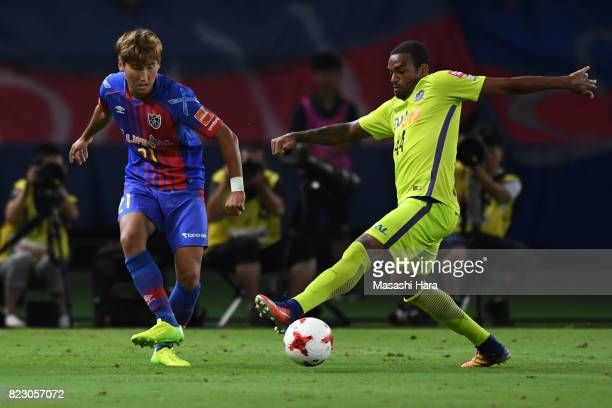 Yu Insoo of FC Tokyo and Anderson Lopes of Sanfrecce Hiroshima compete for the ball during the JLeague Levain Cup PlayOff Stage first leg match...