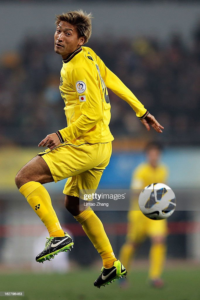 Yu Kimura of Kashiwa Reysol heads the ball during the AFC Champions League match between Guizhou Renhe and Kashiwa Reysol at Olympic Sports Center on February 27, 2013 in Guiyang, China.
