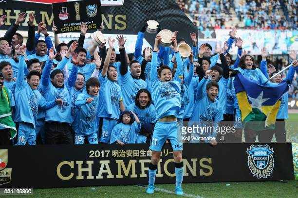 Yu Kobayashi and Kawasaki Frontale players celebate the JLeague Champions at the award ceremony after the JLeague J1 match between Kawasaki Frontale...