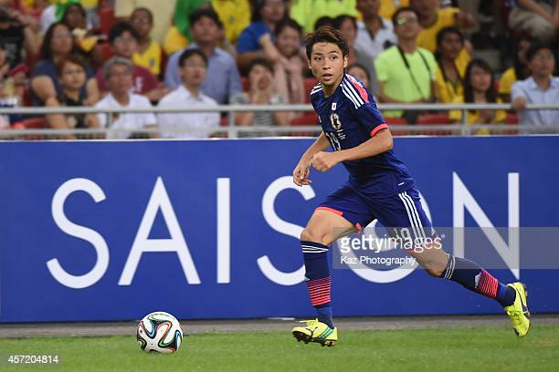 Yu Kobayashi of Japan dribbles the ball during the international friendly match between Japan and Brazil at the National Stadium on October 14 2014...