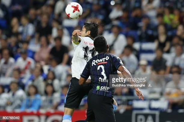 Yu Kobayashi of Kawasaki Frontale and Fabio of Gamba Osaka compete for the ball during the JLeague J1 match between Gamba Osaka and Kawasaki Frontale...