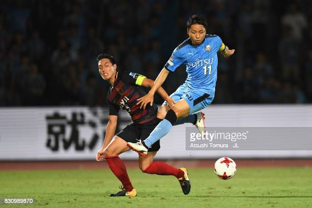 Yu Kobayashi of Kawasaki Frontale and Gen Shoji of Kashima Antlers compete for the ball during the JLeague J1 match between Kawasaki Frontale and...