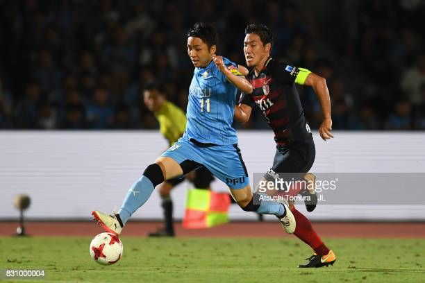 Yu Kobayashi of Kawasaki Frontale and Gen Shoji of Kashima Antlers compete for the ball during during the JLeague J1 match between Kawasaki Frontale...