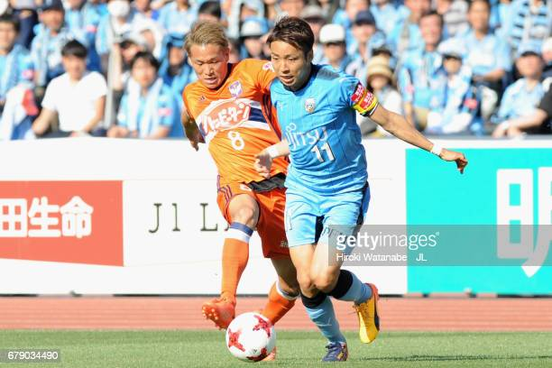 Yu Kobayashi of Kawasaki Frontale and Kei Koizumi of Albirex Niigata compete for the ball during the JLeague J1 match between Kawasaki Frontale and...