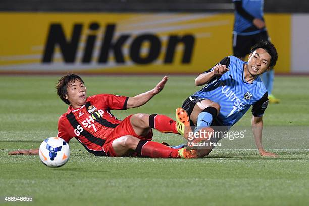 Yu Kobayashi of Kawasaki Frontale and Kim Chiwoo of FC Seoul compete for the ball goal during the AFC Champions League Round of 16 match between...