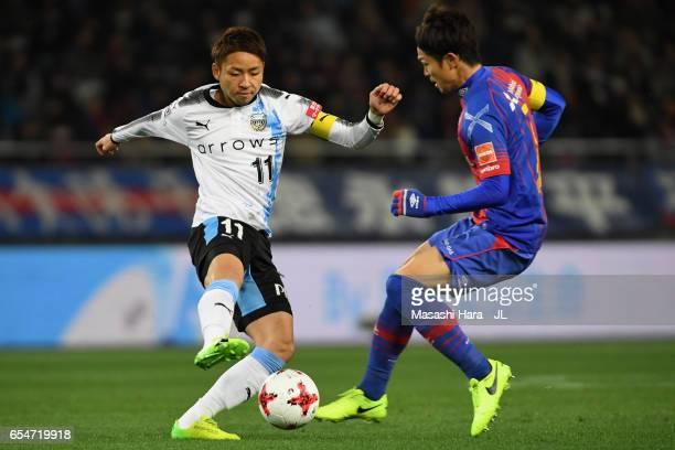 Yu Kobayashi of Kawasaki Frontale and Masato Morishige of FC Tokyo compete for the ball during the JLeague J1 match between FC Tokyo and Kawasaki...