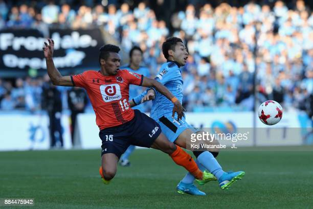 Yu Kobayashi of Kawasaki Frontale and Mateus of Omiya Ardija compete for the ball during the JLeague J1 match between Kawasaki Frontale and Omiya...