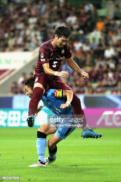 Yu Kobayashi of Kawasaki Frontale and Takuya Iwanami of Vissel Kobe compete for the ball during the JLeague J1 match between Vissel Kobe and Kawasaki...