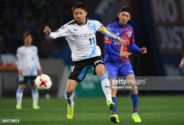 Yu Kobayashi of Kawasaki Frontale and Yojiro Takahagi of FC Tokyo compete for the ball during the JLeague J1 match between FC Tokyo and Kawasaki...