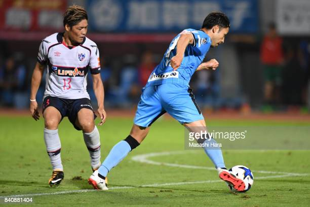 Yu Kobayashi of Kawasaki Frontale and Yoshito Okubo of FC Tokyo and compete for the ball during the JLeague Levain Cup quarter final first leg match...
