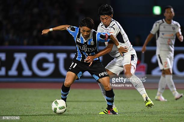 Yu Kobayashi of Kawasaki Frontale and Yuichi Maruyama of FC Tokyo compete for the ball during the JLeague match between Kawasaki Frontale and FC...