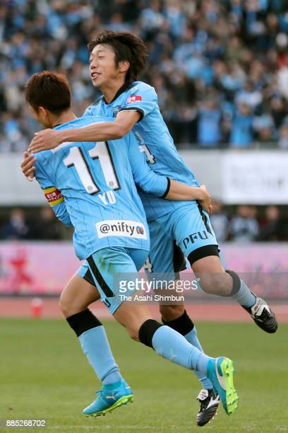 Yu Kobayashi of Kawasaki Frontale celebrates scocring his side's fourth and hat trick goal with his team mate Kengo Nakamura during the JLeague J1...