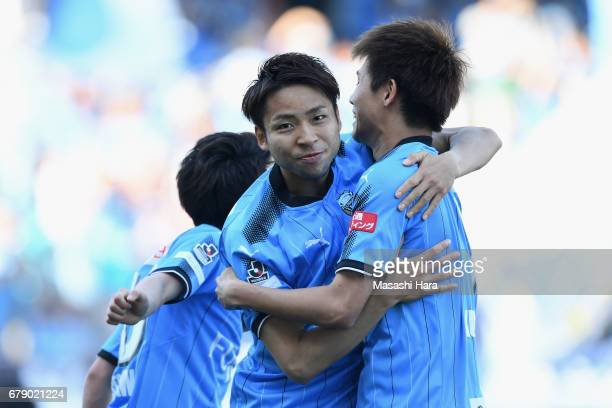 Yu Kobayashi of Kawasaki Frontale celebrates scoring his side's second goal with his team mate Shintaro Kurumaya during the JLeague J1 match between...