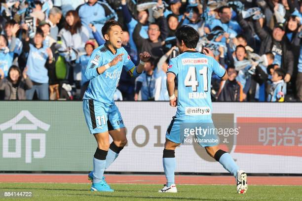 Yu Kobayashi of Kawasaki Frontale celebrates scoring his side's second goal with his team mate Akihiro Ienaga during the JLeague J1 match between...