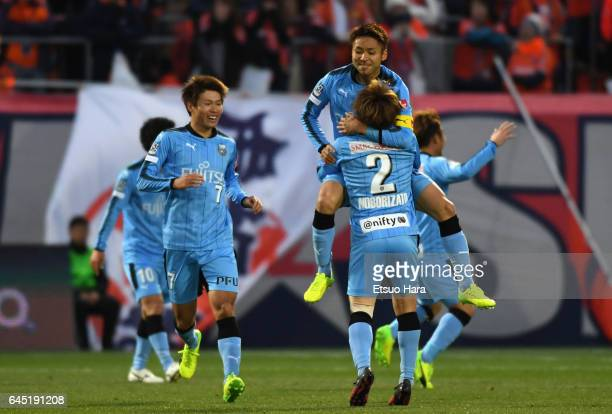 Yu Kobayashi of Kawasaki Frontale celebrates scoring the opening goal with his team mates during the JLeague J1 match between Omiya Ardija and...