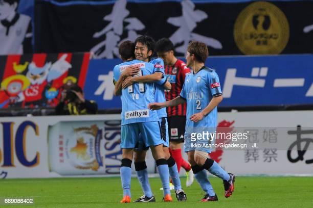 Yu Kobayashi of Kawasaki Frontale celebrates scoring the opening goal with his team mates Kengo Nakamura and Kyohei Noborizato during the JLeague J1...
