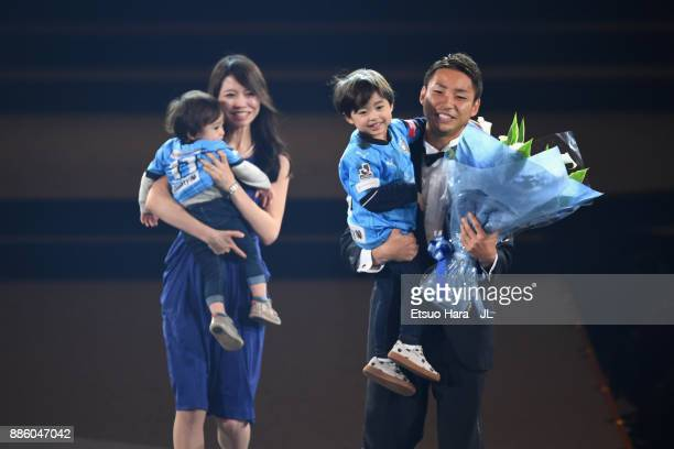 Yu Kobayashi of Kawasaki Frontale celebrates the JLeague Player of the Year Award with his wife and children during the 2017 JLeague Awards at...