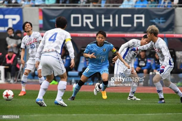 Yu Kobayashi of Kawasaki Frontale controls the ball under pressure of Ventforet Kofu defense during the JLeague J1 match between Kawasaki Frontale...