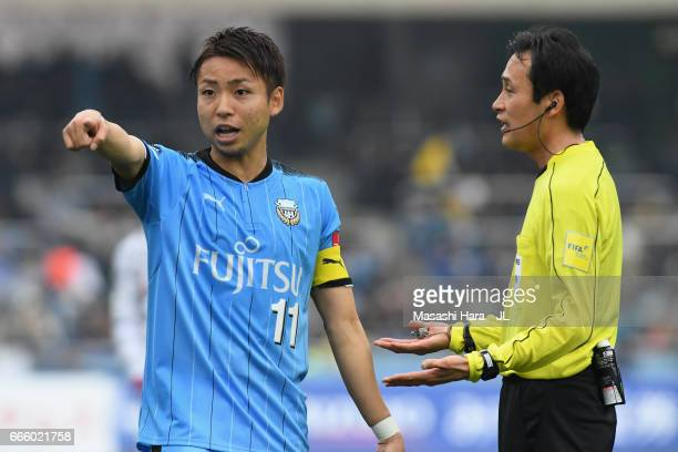 Yu Kobayashi of Kawasaki Frontale instructs his players during the JLeague J1 match between Kawasaki Frontale and Ventforet Kofu at Todoroki Stadium...