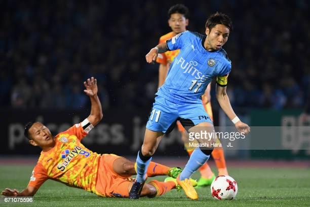 Yu Kobayashi of Kawasaki Frontale is challenged by Chong Tese of Shimizu SPulse during the JLeague J1 match between Kawasaki Frontale and Shimizu...