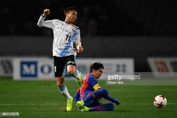 Yu Kobayashi of Kawasaki Frontale is tackled by Masato Morishige of FC Tokyo during the JLeague J1 match between FC Tokyo and Kawasaki Frontale at...