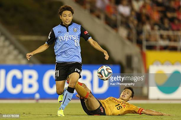 Yu Kobayashi of Kawasaki Frontale is tackled by Yuki Honda of Nagoya Grampus during the JLeague match between Nagoya Grampus and Kawasaki Frontale at...