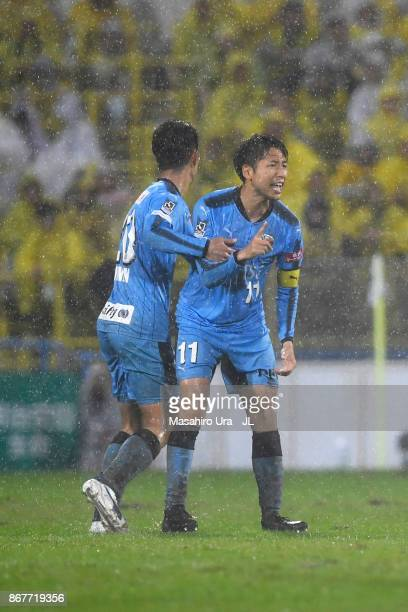 Yu Kobayashi of Kawasaki Frontale reacts after scoring his side's second goal with his team mate Kei Chinen during the JLeague J1 match between...