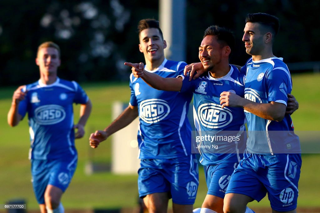 Yu Kuboki, William Angel and Radovan Pavicevic of Olympic FC celebrate a goal during the NSW NPL Men's match between Sydney Olympic FC and Parramatta FC on June 18, 2017 in Sydney, Australia.